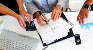 stock image of people calculating expenses